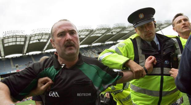 Referee Martin Sludden protected by the Gardai at the end of the Leinster final.