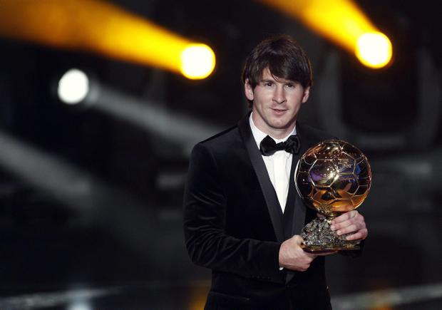 Barcelona's Lionel Messi with his award for Player of the Year during the FIFA Ballon d'or Gala last night