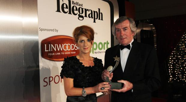 AP McCoy's sister receives the Hall of Fame award from Pat Jennings.
