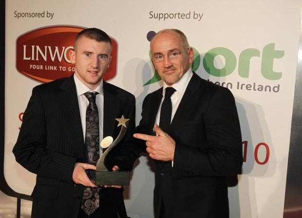 Player of the Year, boxer Paddy Barnes accepts his award from boyhood hero Barry McGuigan.