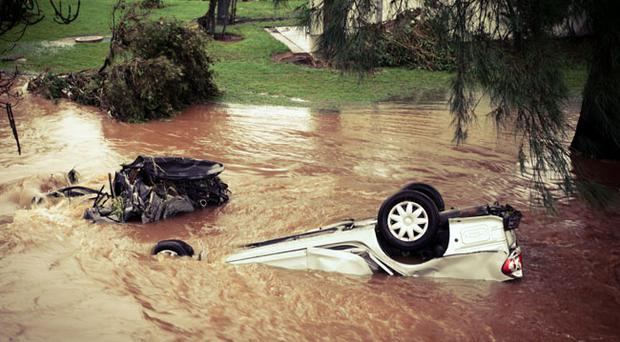 Debris and an overturned car is seen in central Toowoomba