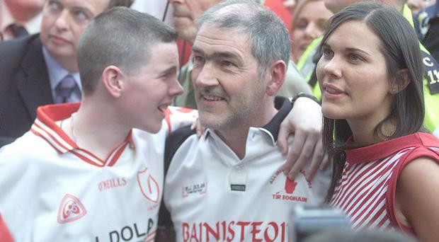 Tyrone manager Mickey Harte with his son David and daughter Michaela after his side's win at Croke Park