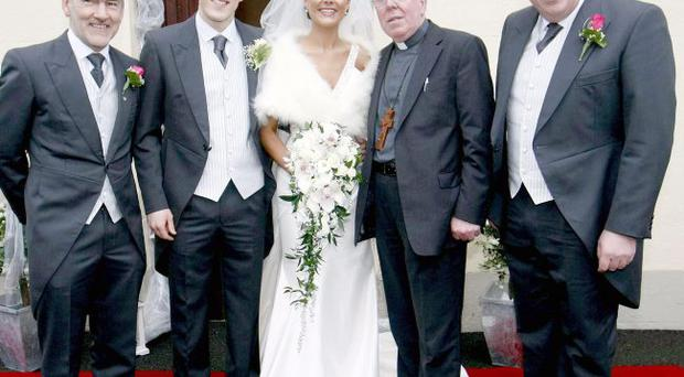 Irish News handout of (left to right) Mickey Harte, John McAreavey, Michaela Harte, Bishop John McAreavey and Brendan McAreavey on the wedding day of Michaela Harte and John McAreavey at St. Malacheys Church Ballymacilrory on December 30, 2010. Michaela, the daughter of Tyrone GAA manager Mickey Harte was murdered in her hotel room, police in Mauritius confirmed today.