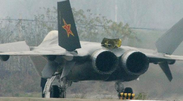 A Chinese J-20 stealth plane is seen after finishing a runway test in Chengdu (AP)