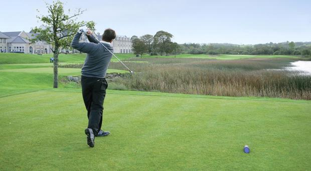 Nick Faldo tees off at the Lough Erne course he designed.