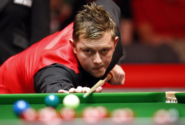 Mark Allen on his way to victory over Ronnie O'Sullivan at the Masters yesterday.