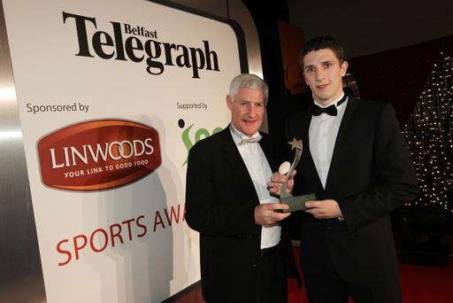 Blackpool and Northern Ireland star Craig Cathcart accepts the George Best Breakthrough award from Nigel Worthington.