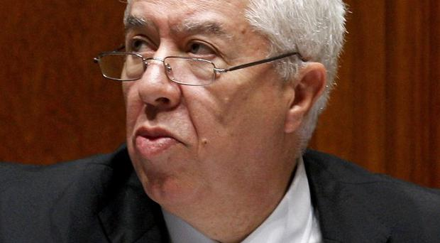 Portuguese finance minister Fernando Teixeira dos Santos said the country is taking steps to reduce debt (AP)