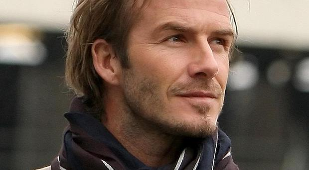 David Beckham is second to British fathers when it comes to being a role model