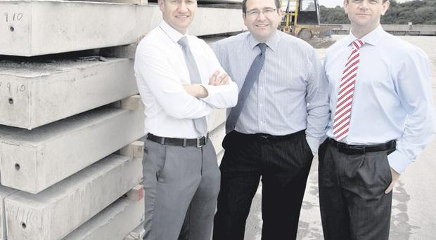 Bullivant Taranto operations director Niall Woods (left) with managing director Simon Bullivant and commercial manager John Stenson (right)