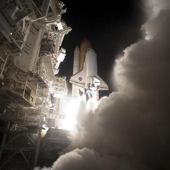 Space shuttle Discovery lifts off on April 5, last year (AP)