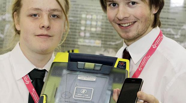 Lucas Grange (left) and Owen Killian from Belvedere with their iPhone defibrillator experiment
