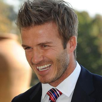 David Beckham, soon to be a dad for the fourth time, is considered a good role model by young boys