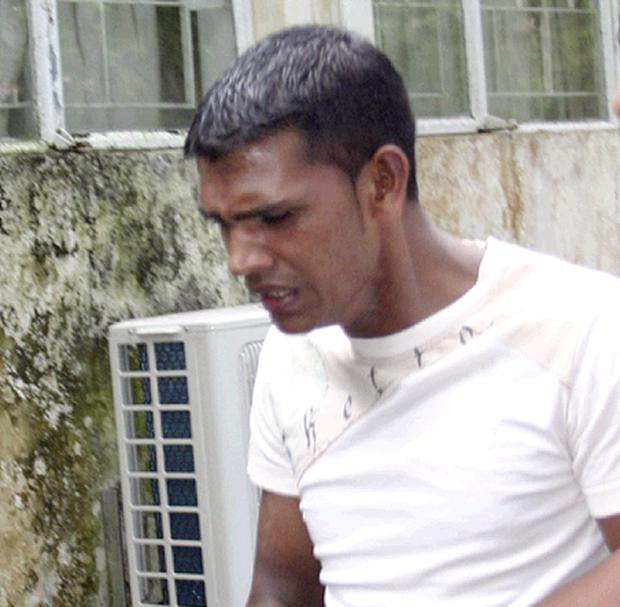 Suspect Avinash Treebhoowoon (29) is brought to Mapou Court, Port Louis Mauritius, Wednesday, Jan.12, 2011. The room attendant has been charged with the murder of Michaela McAreavey.