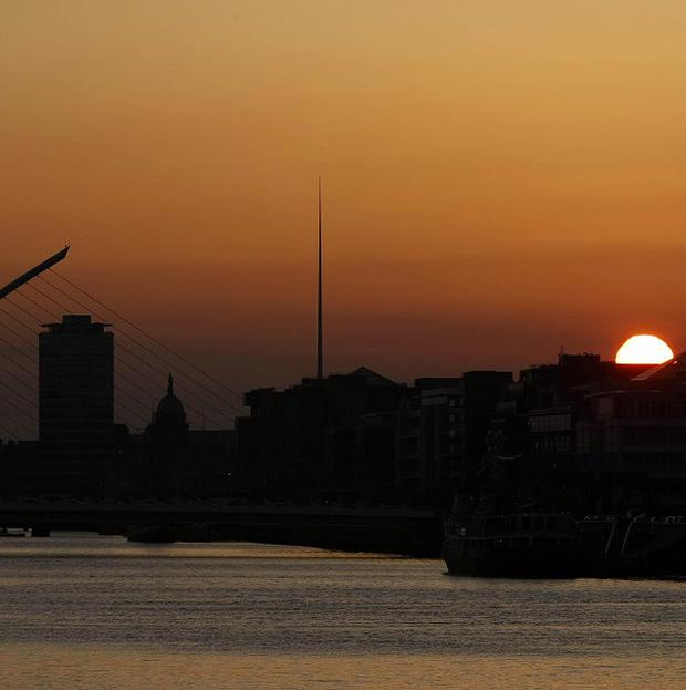 The sun set on the river Liffey in Dublin. Tourism chiefs are hoping to tempt more holidaymakers to Ireland