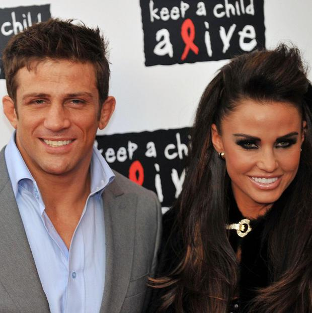Katie Price has called on people to stop speculating about the state of her marriage to Alex Reid