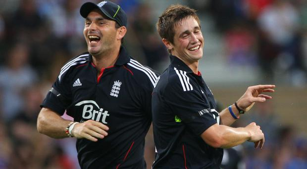 Michael Hardy and Chris Woakes of England celebrate the wicket of Cameron White of Australia during the First Twenty20 International Match between Austtalia and England at Adelaide Oval on January 12, 2011 in Adelaide, Australia.