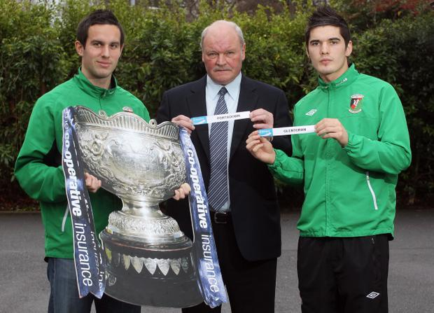 Portadown boss Ronnie McFall flanked by Glentoran duo Andy Waterworth and Jimmy Callacher at yesterday's Co-operative Insurance Cup draw.