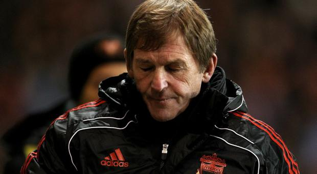 Liverpool Manager Kenny Dalglish reacts during the Barclays Premier League match between Blackpool and Liverpool at Bloomfield Road on January 12, 2011 in Blackpool, England.