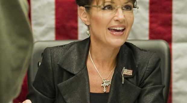 Sarah Palin has hit back at critics who blame her hardline election campaigning for the Tucson massacre (AP)