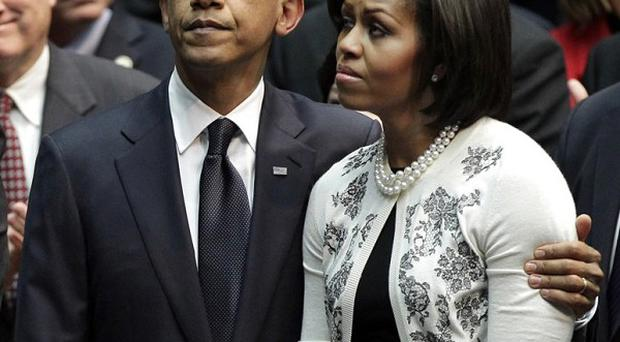 Barack Obama and first lady Michelle Obama attend memorial service for the victims of the Arizona shootings (AP)