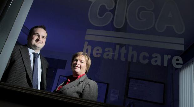 Neil Armstrong, Sales Director of CIGA in Ballymena, with Dr Vicky Kell, Invest NI Trade Director.