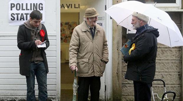 A voter leaves a polling station in Oldham as the constituency votes in the by-election