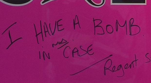 A close-up of writing on a sign in the window of an Accessorize store on Regent Street