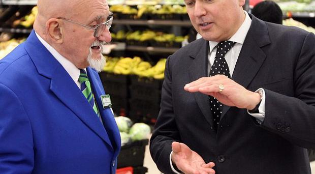 Employees over 65 - such as Asda worker Roy Gill, seen here talking to Tory minister Iain Duncan Smith - will no longer be forced to retire