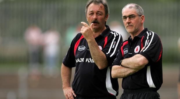 Tony Donnelly (left) was set to deputise following the tragic death of Mickey Harte's daughter Michaela McAreavey but the Ulster Council has decided to to postpone Tyrone's match.