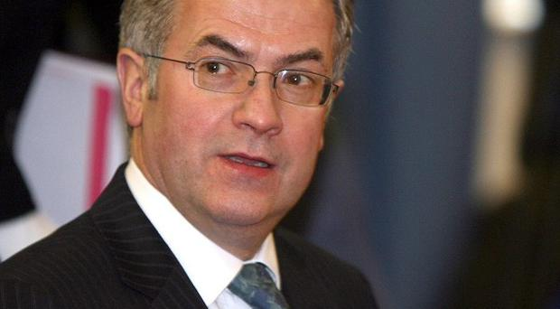 Social development minister Alex Attwood has pledged to protect jobs in his department and agencies