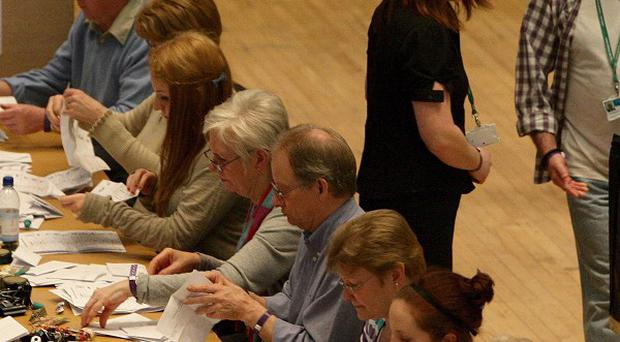 Ballot papers are placed on tables before counting in the Oldham East and Saddleworth by-election
