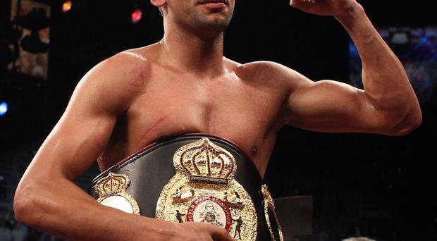 Paul McCloskey is confident that he can defeat Amir Khan (pictured) if they meet in April.