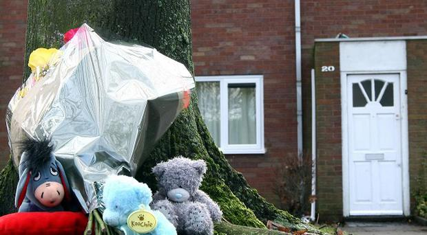 Tributes left at a house in Ward End, Birmingham, following the death of two-year-old Keanu Williams on Sunday