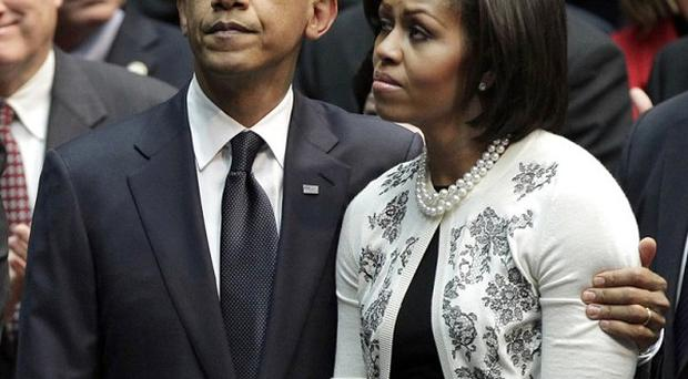 Barack Obama and his wife Michelle attend a memorial service for the victims of the Arizona shootings (AP)