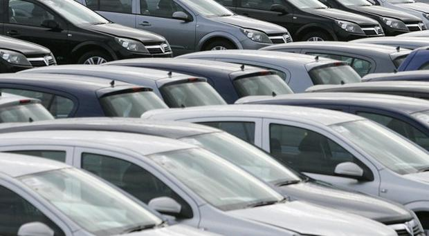 Cars sales in Northern Ireland have dropped, ending a year of relative recovery for the industry