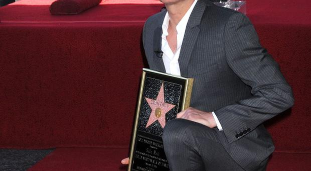 Colin Firth is honoured with a star on the Hollywood Walk of Fame (AP)