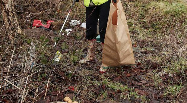 Sustrans volunteer Janet Dunn collects litter on the Comber Greenway