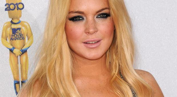 Lindsay Lohan will have to wait and see if she is to be charged over an alleged incident at a rehab centre
