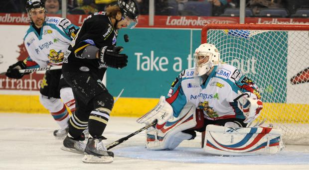 Stephen Murphy of the Belfast Giants makes a save to deny Matt Myers of the Nottingham Panthers at the Odyssey Arena last night.