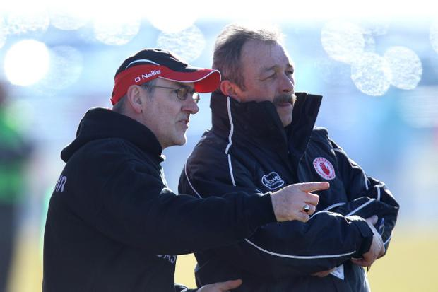 Tony Donnelly (right), along with team trainer Fergal McCann, will take charge of Tyrone in midweek in the absence of Mickey Harte (left).