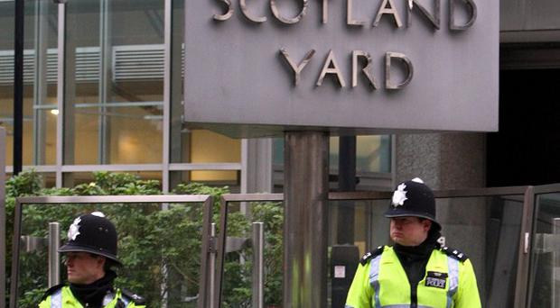 A 14-year-old boy has been arrested over the throwing of a petrol bomb during a student protest