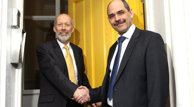 Alliance Party Leader David Ford welcomes Harry Hamilton into the Party at their Headquarters in Belfast.