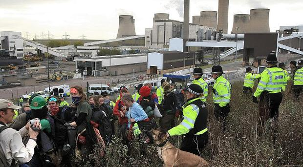 Climate change protesters confront police near the Ratcliffe-on-Soar power station