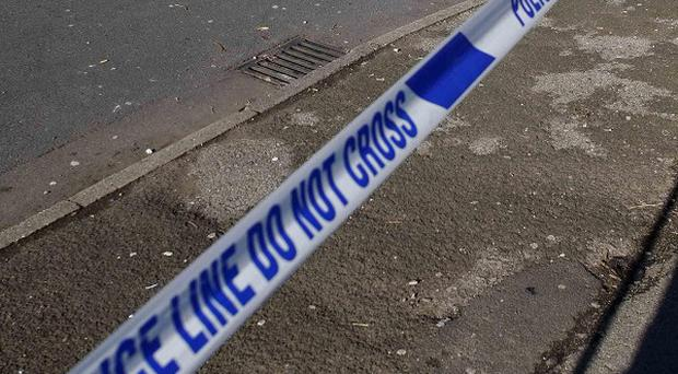 A 23-year-old is being questioned on suspicion of murder after one man was killed and two others injured