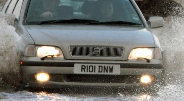 Roads begin to flood outside Edinburgh as downpours and melting snow sparked warnings of localised flooding