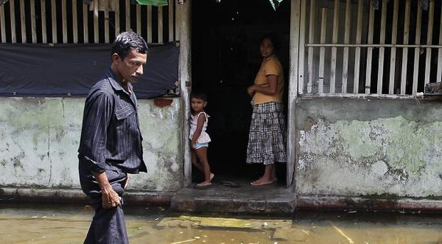 The United Nations has said it will appeal for emergency flood aid for Sri Lanka, where 37 people have died (AP)