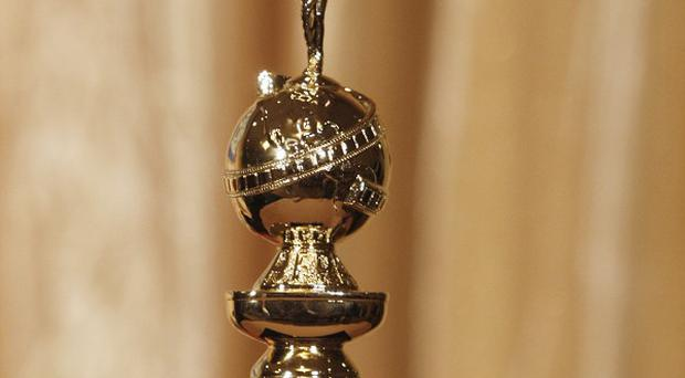 A former publicist is suing the Golden Globes on the eve of the awards