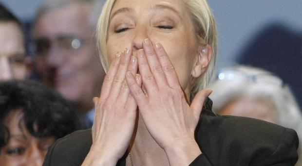 Marine Le Pen, left, reacts after she was elected as the new president of France's far-right National Front party. (AP)
