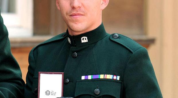 Ranger Alan Owens, The Royal Irish Regiment, after being decorated with The Military Cross for services in Afghanistan